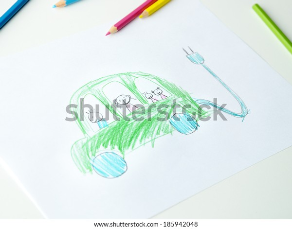 Close-up of childs hands drawing a green electric zero emission car
