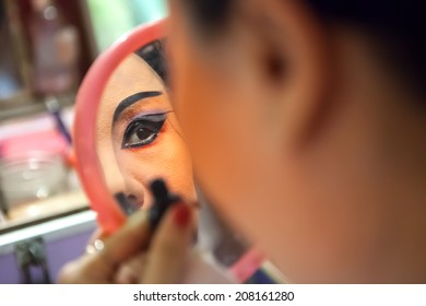 Close-up of a chinese opera actress is doing the make up