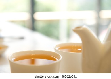 Close-up of Chinese tea in cups with teapot.