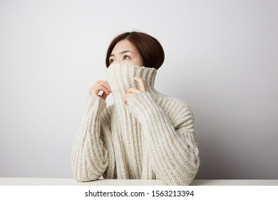 Close-up of Chinese woman posing on the white background. Isolated.