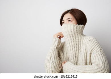 Close-up of Chinese young woman posing on the white background. Isolated.