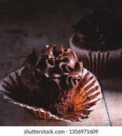 Closeup of a chocolate cupcake with a dark background