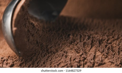 Close-up chocolate ice cream scooping background
