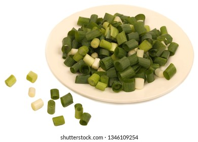 Closeup Chopped fresh green leaf onions isolated on white background