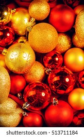 Close-up Christmas background with a lot of Christmas red and golden balls.