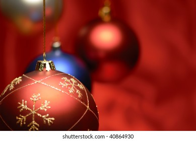 Closeup of christmas ball on red background.