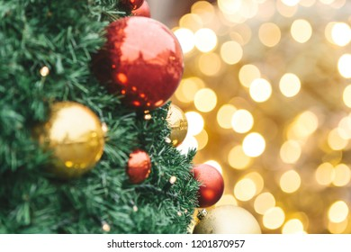 Close-up of Christmas decorations. Red and gold balls on a Christmas tree.