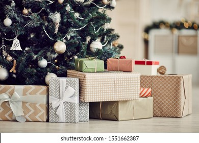 Close-up of Christmas presents in wrapping paper are on the floor under the Christmas tree