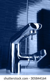 closeup of chrome bathroom faucet