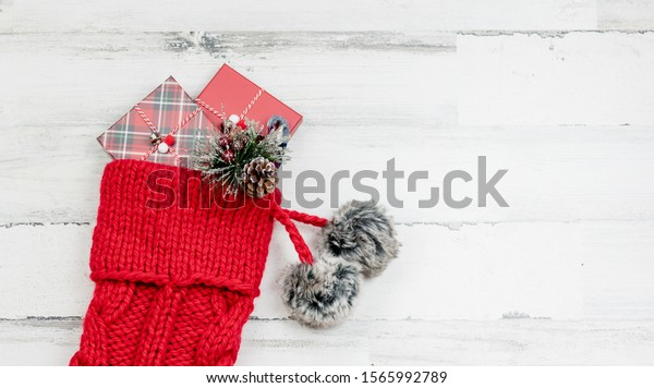 Closeup of chunky knit red Christmas stocking on white background with space for copy