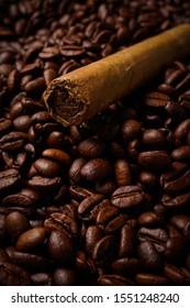 Closeup of cigar and coffee beans