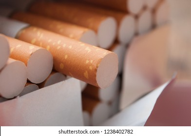 closeup of cigarettes in cigarettes pack  on wooden table background