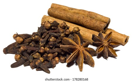 Close-up of cinnamon, clove and badian isolated on white background.