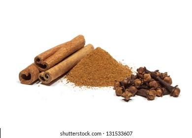 Close-up of cinnamon and clove isolated on white background.