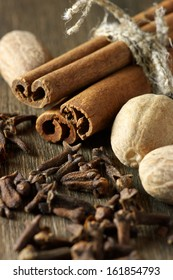 Close-up of cinnamon, nutmeg and cloves.
