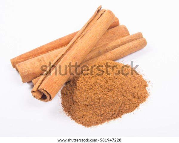 Close-up of cinnamon sticks on a white background.