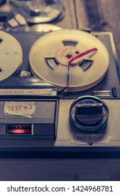 Closeup of classic audio tape recorder and roll of tape
