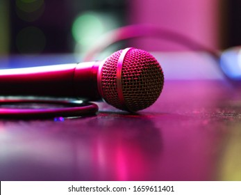 Closeup of classic microphone at concert on stage with shallow depth of field