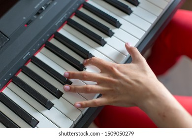 Close-up of a classic music performer's hand playing the piano or electronic synthesizer (piano keyboard) left hand