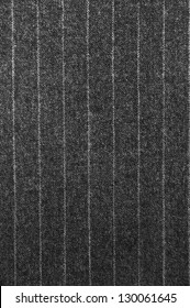 Close-up of a classic pinstriped wool suit fabric.