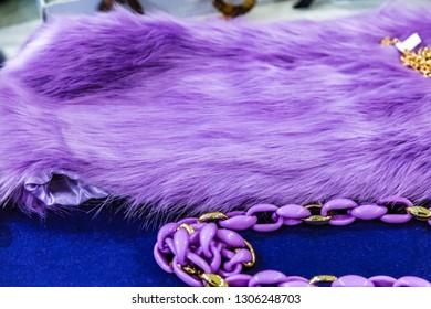 closeup of classy purple fur and chain