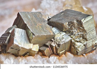 Close-up of clasters of pyrite and quartz crystals background. Texture of crystals of pyrite. Raw specimen of pyrite crystal stone. Selective focus