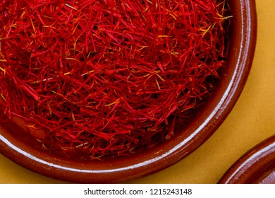 Close-up of a clay bowl, containing saffron pistils