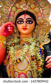 Closeup of Clay idol of Hindu Goddess Durga during Durga Puja festivals in Kolkata city, West Bengal, India