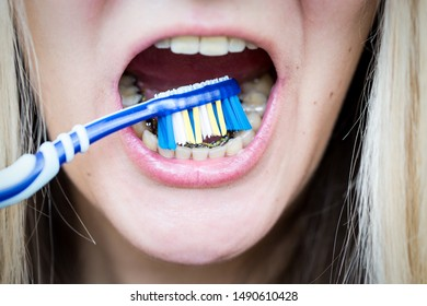 close-up, cleaning teeth with invisible internal lingual braces, orthodontic treatment, hygienic care with a toothbrush