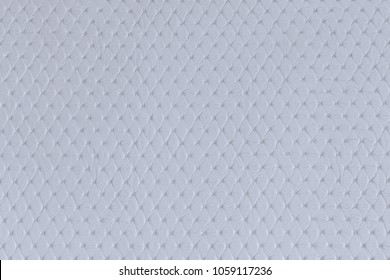 Close-up clear white leather with pattern and texture in soft lighting background.