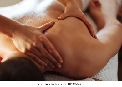Close-up of a client's back being massaged