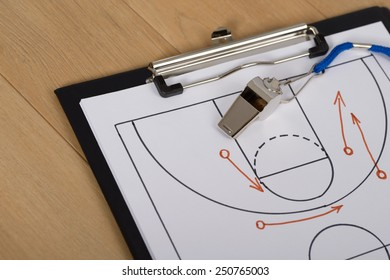 Close-up Of Clipboard With Whistle And Sport Tactics On Paper