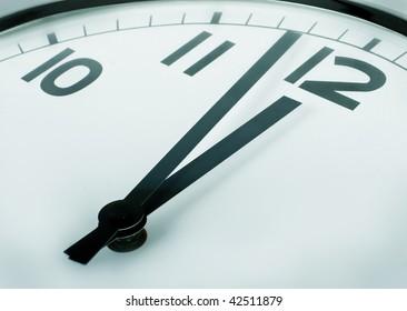 a closeup of a clock sign minutes to twelve