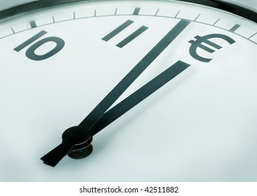 close-up of a clock where number twelve is the euro currency symbol