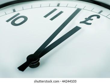 closeup of a clock where the twelve o'clock sign pound symbol
