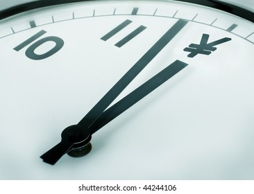 close-up of a clock where the twelve o'clock sign dollar symbol
