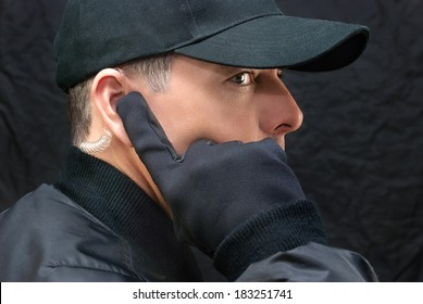 Close-up of a close protection guard scanning for threats.