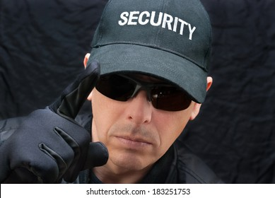 Close-up of a close protection officer gives warning.