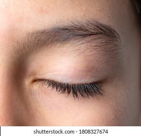 Close-up of closed eye beautiful eyebrown and long eyelash, natural look no make up