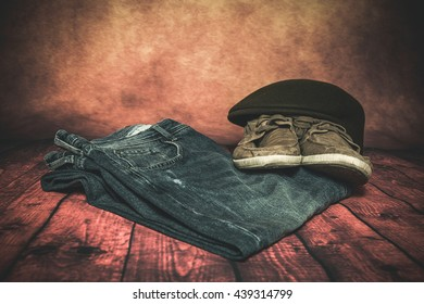 Close-up of Clothing and fashion accessories on wooden table