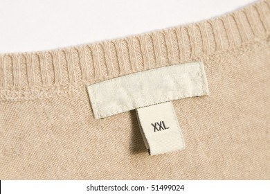 close-up of clothing label with xxl size