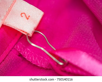 Closeup of clothing size tag or label.