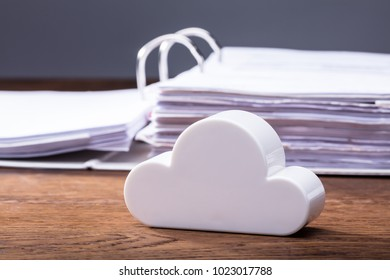 Close-up Of Clouds Block In Front Of Folders On The Wooden Table