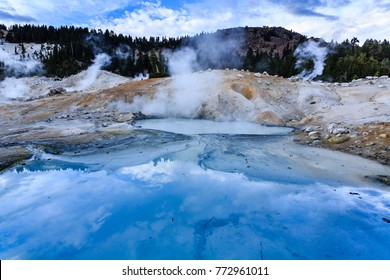 Closeup of clouds seeming to float on the colorful waters over the  dangerous boiling springs and hot mud pots in Lassen Volcanic National Park