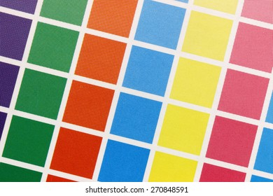 Close-up of a a cmyk test print with many color squares from above