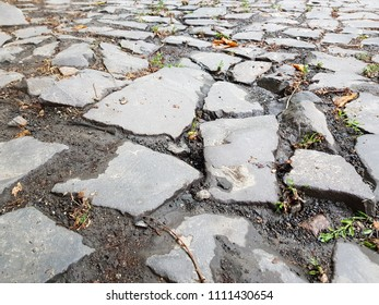 Close-up cobblestone pavement, stone street pavement background with selective focus. Stone road texture, cobblestone background
