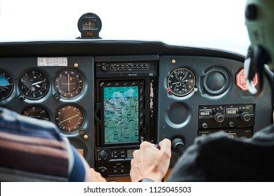 Closeup of a cockpit of cessna skyhawk 172 airplane with two pilots.