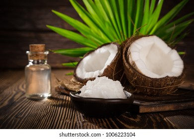 close-up of a coconut oil on old wooden background