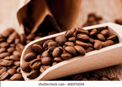 Closeup of coffee beans background.coffee beans on wooden table