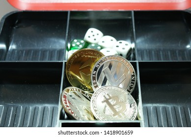 closeup of a collection of cryptocurrency in a lockbox